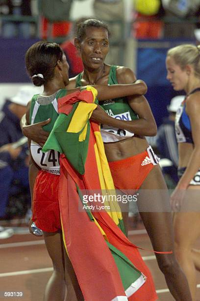 Derartu Tulu of Ethiopia hugs teammate Berhane Adere after winning the women's 10000m final at the 8th IAAF World Athletic Championships in Edmonton...
