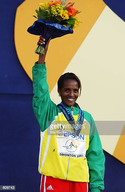 Derartu Tulu of Ethiopia winner of the gold medal for the women's 10000m waves to the crowd during the 8th IAAF World Athletic Championships in...