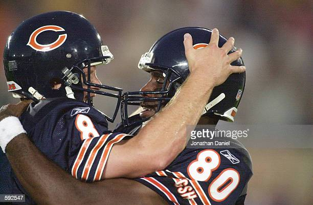 Dez White of the Chicago Bears and his Quarterback Cade McNown celebrate during the NFL preseason game against the Cincinnati Bengals at Soldier...