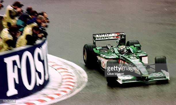 Eddie Irvine of Northern Ireland and Jaguar in action at La Source hairpin during first practice for the Formula One Belgian Grand Prix at...