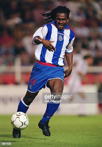 Emerson of Deportivo La Coruna runs with the ball during the Teresa Herrera tournament match against Real Madrid played at the Estadio Riazor, in La...