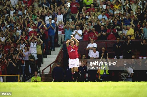 Eric Cantona of Manchester United acknowledges the crowd during the Ryan Giggs Testimonial match against Celtic played at Old Trafford in Manchester...