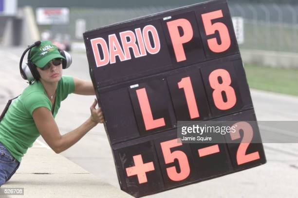 Film actress Ashley Judd holds out the pit board for Team KOOL Green driver Dario Franchitti during the Miller Lite 200 round thirteen of the CART...