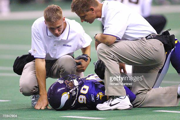 Gabe Northern of the Minnesota Vikings gets attended to by field physicians after getting hurt during the preseason game against the New Orleans...