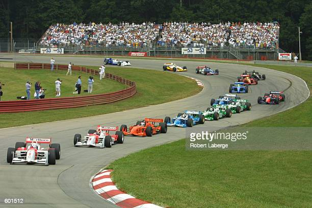 Gil de Ferran and Marlboro Team Penske teammate Helio Castroneves lead at the start of the Miller Lite 200 Round 13 of the CART FedEx Championship...