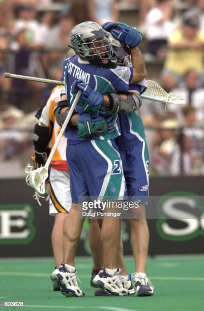 Goalie Greg Cattrano and Brian Reese of the Baltimore Bayhawks celebrate their 1211 win over the Rochester Rattlers in Major League Lacrosse action...