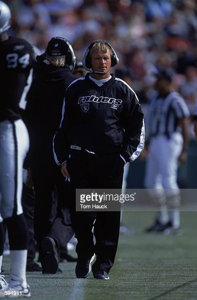 Head Coach Jon Gruden of the Oakland Raiders standing on the sidelines watching the action during the PreSeason game against the San Francisco 49ers...