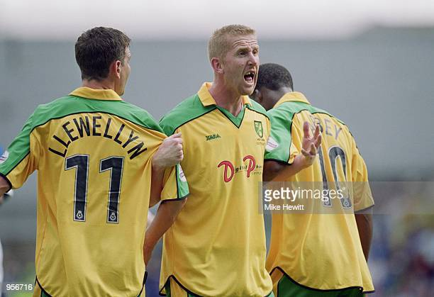 Iwan Roberts of Norwich City organises the defensive wall during the Nationwide League Division One match against Millwall played at The New Den in...