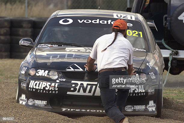 Jason Richards in the NZ Business Commordore spins off the track during the Queensland 500 V8 Supercar practice held at the Queensland Raceway...