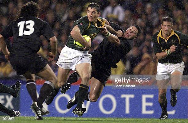 Joost van der Westhuizen of South Africa is tackled by Byron Kelleher of the All Blacks during the Tri Nations match between New Zealand and South...