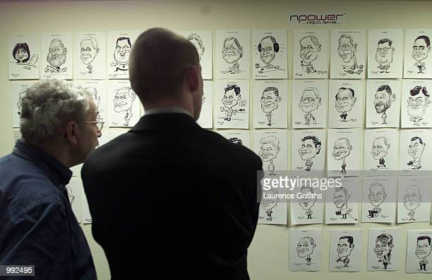 Journalists look at the Npower cartoon drawings during the Fourth Test Match between England and Australia at Headingley Leeds DIGITAL IMAGE...