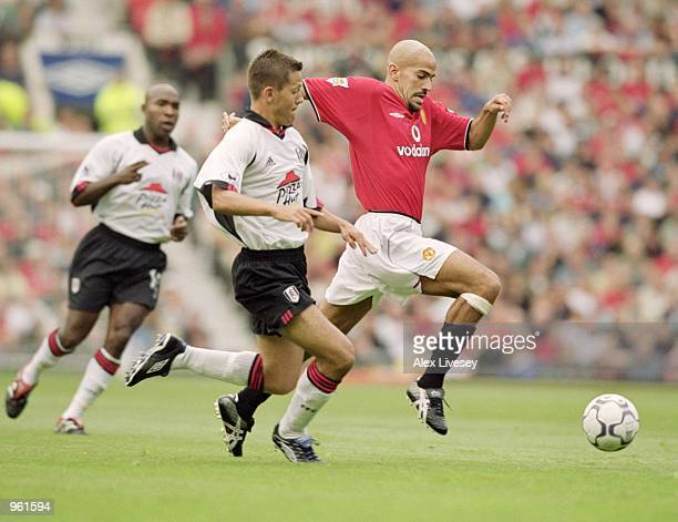 Juan Sebastian Veron of Manchester United takes on Jon Harley of Fulham during the FA Barclaycard Premiership match at Old Trafford in Manchester...