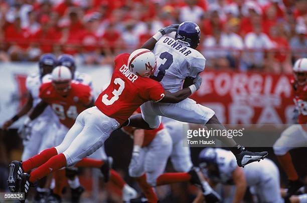 Keyuo Craver of the Nebraska Cornhuskers tackeling Latarence Dunbar during the game against the Texas Christian Horned Frogs at Memorial Stadium in...