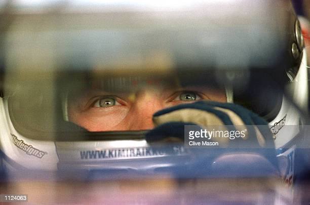 Kimi Raikkonen of Finland and Sauber studies his lap times during qualifying for the Hungarian Grand Prix in Budapest Hungary Mandatory Credit Clive...
