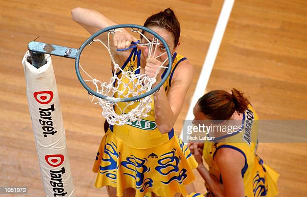 Liz Ellis of the Swifts cuts down the net after victory during the Commonwealth Bank Trophy Netball Grand Final between the Sydney Swifts and the...