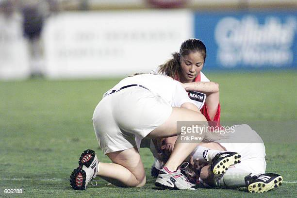 Lorrie Fair of the Philadelphia Charge attends to her teammate Kelly Smith who got hurt during the WUSA playoff game against the Atlanta Beat at...
