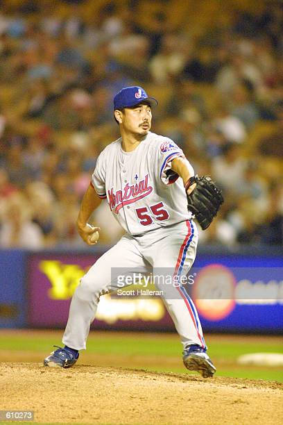 Masato Yoshii 55 of the Montreal Expos hurls a pitch against the Los Angeles Dodgers at Dodger Stadium in Los Angeles California DIGITAL IMAGE...
