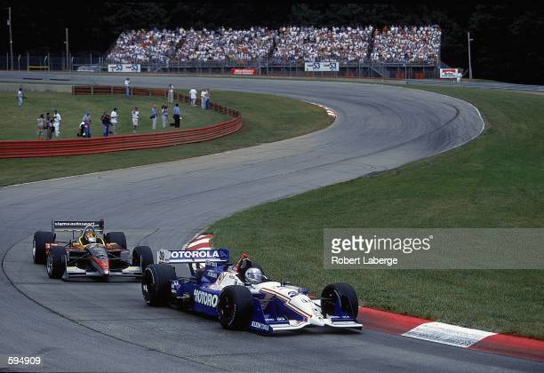 Michael Andretti of the USA who drives a Honda Reynard for Team Motorola comes around a corner during the Miller Lite 200 part of the CART FedEx...
