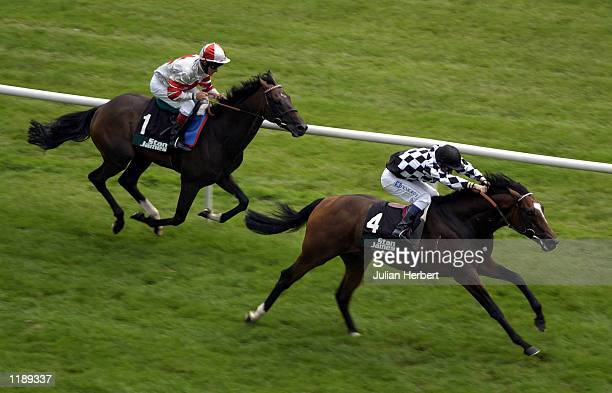 Michael Hills and Mr Combustible lead the Pat Eddery ridden Millenary home to land The Stan James Geoffrey Freer Stakes run at Newbury DIGITAL IMAGE...