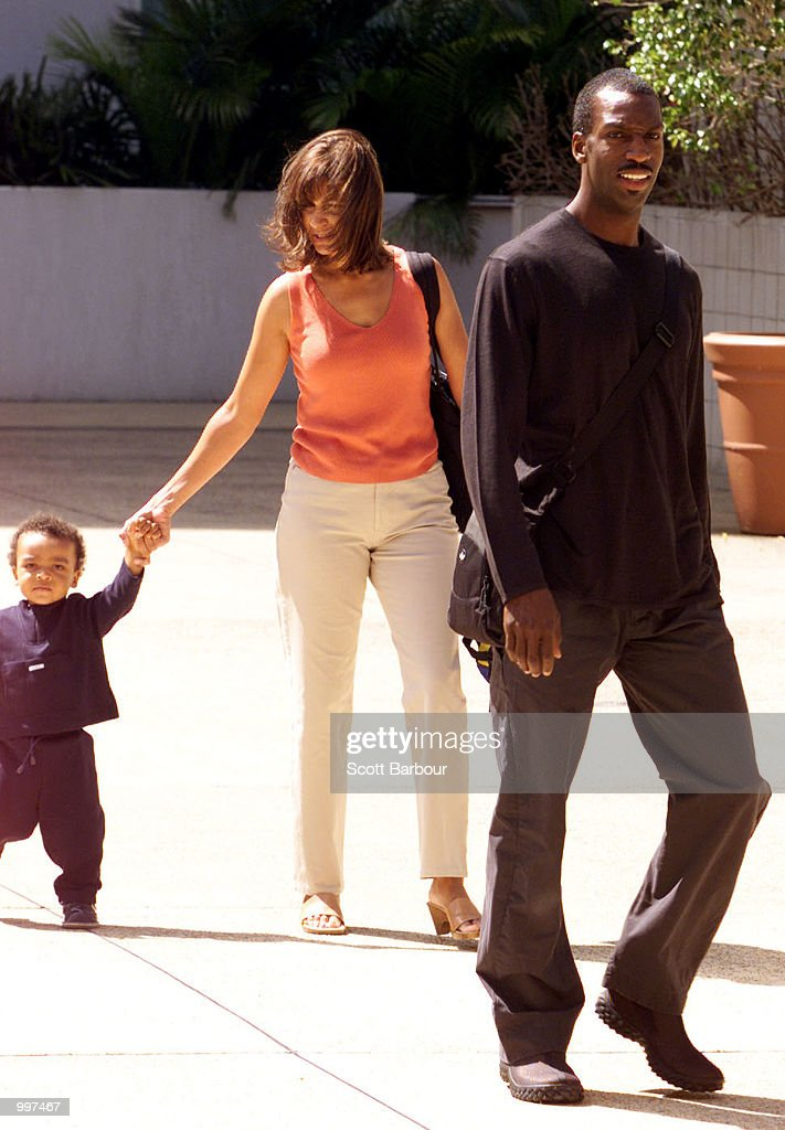 Michael Johnson of the USA, his wife and son behind arrive at a press conference at the Goodwill Games in Brisbane, Australia. DIGITAL IMAGE. Mandatory Credit: Scott Barbour/ALLSPORT