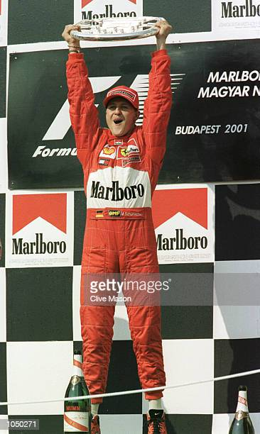 Michael Schumacher of Germany and Ferrari celebrates winning the Hungarian Grand Prix and, a record equalling, 4th World Drivers Championship at the...