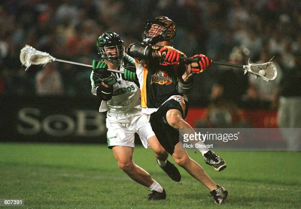 Mike Regan of the Rochester Rattlers winds up to shoot as AJ Hougen of the Long Island Lizards defends in their Major League Lacrosse game at...
