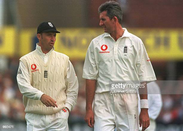 Nasser Hussain chats to Andrew Caddick of England during the second day of the England v Australia fourth NPower test match at Headingley Leeds...