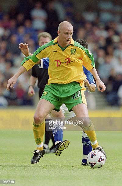 Neil Emblen of Norwich City holds onto the ball during the Nationwide League Division One match against Millwall played at The New Den in London...