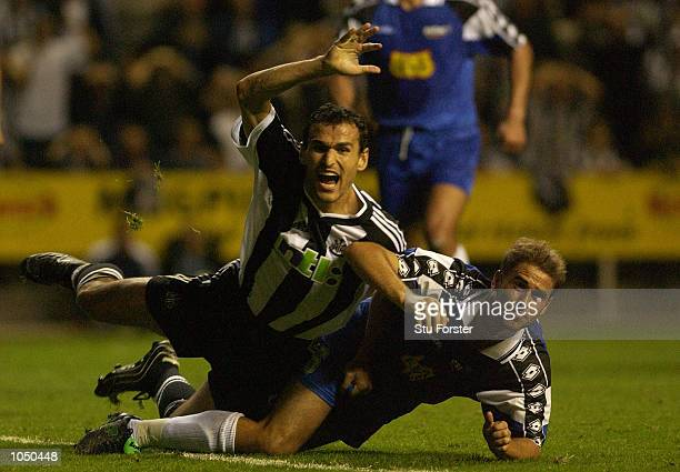Nikos Dabizas of Newcastle is felled by Troyes defender David Hamed during the Intertoto Cup Final Second Leg between Newcastle United and Troyes at...