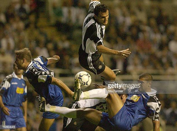 Nikos Dabizas of Newcastle United rises above the Troyes defence during the Intertoto Cup Final Second Leg between Newcastle United and Troyes at St...