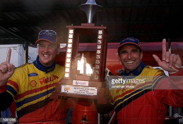 Paul Radisich and Steven Johnson celebrate their victory after being declared winners after a red flag decision by race officials in the Queensland...