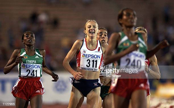 Paula Radcliffe of Great Britain feels the pain after finishing fourth behind Derartu Tulu Gete Wami and Berhane Adere of Ethiopia in the women's...