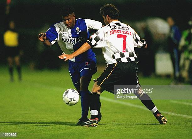 Pena of FC Porto takes the ball past Jorge Silva of Boavista during the Portuguese Super Cup match played in Vila Do Conde Portugal FC Porto won the...