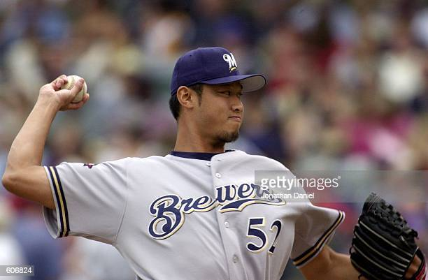 Pitcher Mac Suzuki of the Milwaukee Brewers makes an unscheduled appearence at the top of the second inning against the Milwaukee Brewers at Wrigley...