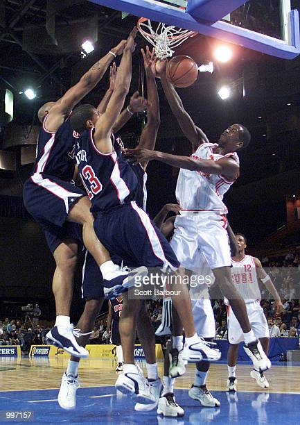 Players compete for a rebound during the USA v Cuba Basketball game at the Goodwill Games in Brisbane Australia DIGITAL IMAGE Mandatory Credit Scott...