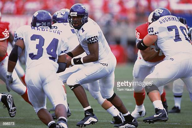 Quarterback Casey Printers of the Texas Christian Horned Frogs handing off the ball to Andy Wingender during the game against the Nebraska...