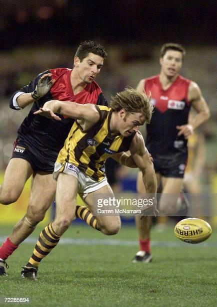 Richard Vandenburg for Hawthorn outruns Adem Yze for Melbourne during the AFL round 19 game between the Melbourne Demons and the Hawthorn Hawks which...