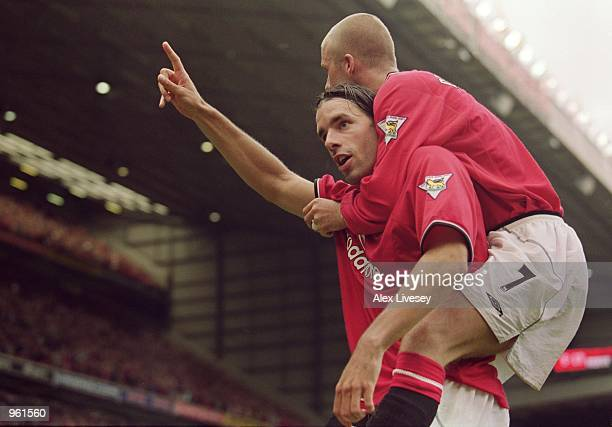 Ruud Van Nistelrooy of Manchester United celebrates scoring the winneing goal with team mate David Beckham during the FA Barclaycard Premiership...