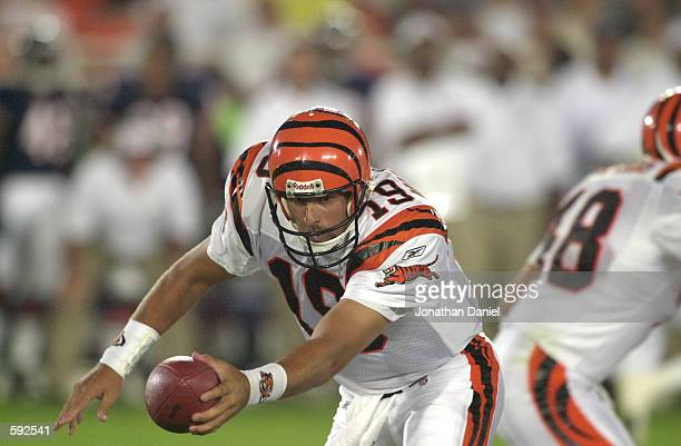 Scott Mitchell of the Cincinnati Bengals hands the ball off during the NFL preseason game against the Chicago Bears at Soldier Field in Chicago IL...