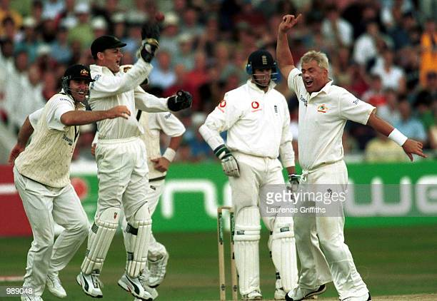 Shane Warne of Australia celebrates the wicket of Marcus Trescothick of England after Adam Gilchrist of Australia catches him off the shin of Matthew...