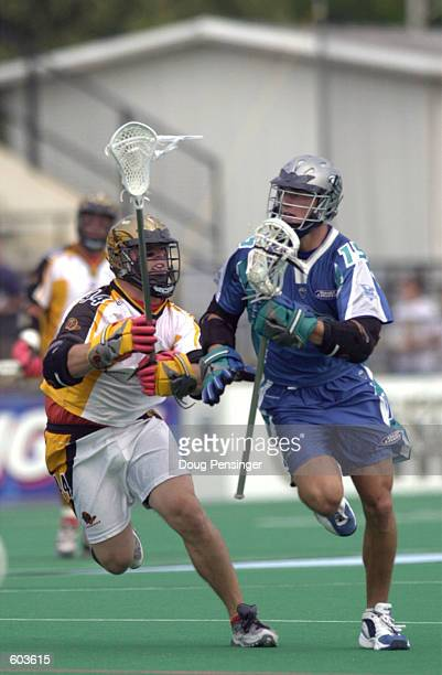Shawn Nadelen of the Baltimore Bayhawks tries to move the ball around the defense of Zach Gagel of the Rochester Rattlers during their Major League...