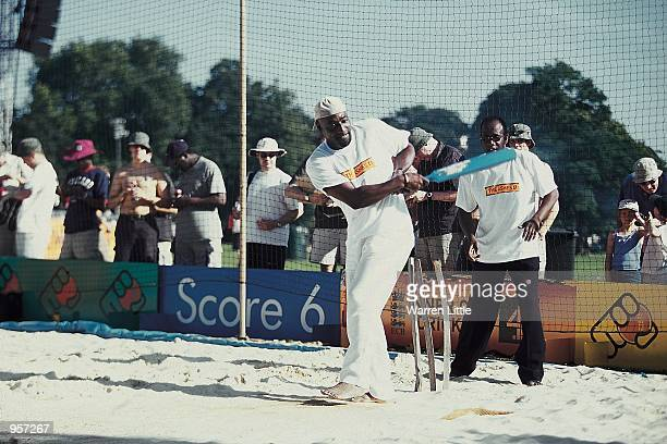 Sir Viv Richards of the West Indies shows off his batting skills during the ECB Cricket Roadshow held at Clapham Common in London Mandatory Credit...