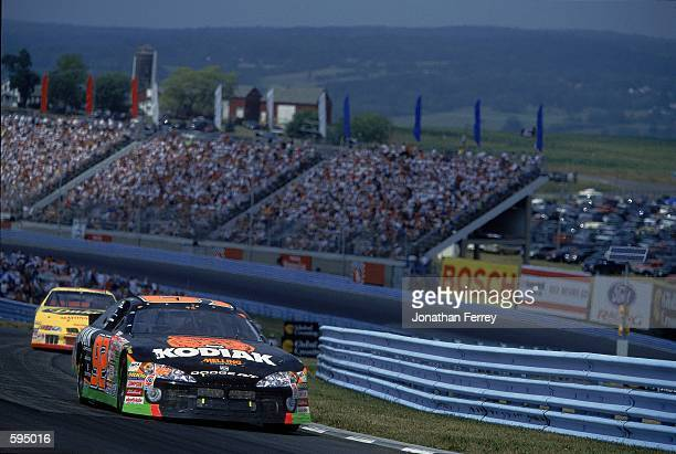 Stacy Compton who drives the Dodge Intrepid for Melling Racing comes down the track during the Global Crossing, part of the NASCAR Winston Cup Series...