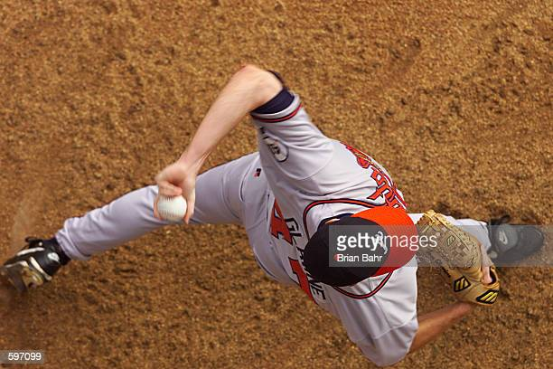 Starting pitcher Tom Glavine of the Atlanta Braves warms up in the bullpen before throwing against the Colorado Rockies at Coors Field in Denver...