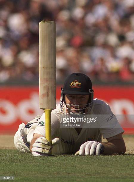 Steve Waugh of Australia celebrates 100 diving for his ground during day two of the Fifth Test between England and Australia at The Oval London...