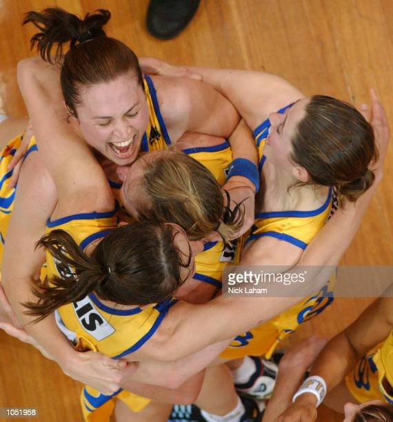 The Swifts celebrate victory in the Commonwealth Bank Trophy Netball Grand Final between the Sydney Swifts and the Adelaide Thunderbirds held at the...