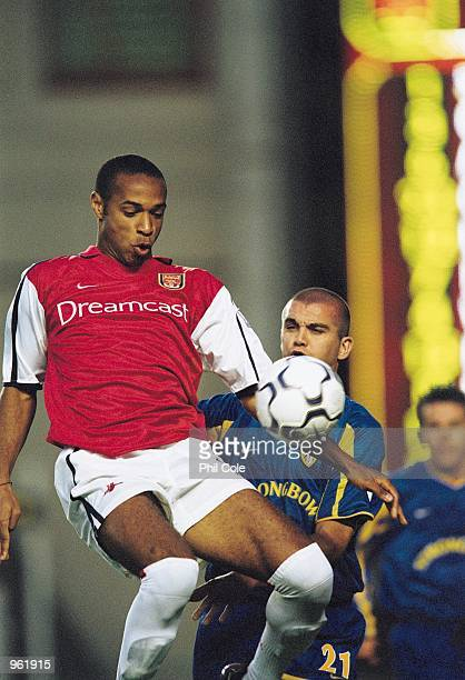 Thierry Henry of Arsenal shields the ball from Dominic Matteo of Leeds during the FA Barclaycard Premiership match between Arsenal and Leeds United...