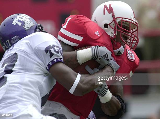 Thunder Collins of Nebraska carries the ball as Charlie Owens of Texas Christian University takes him down during the first half at Memorial Stadium...