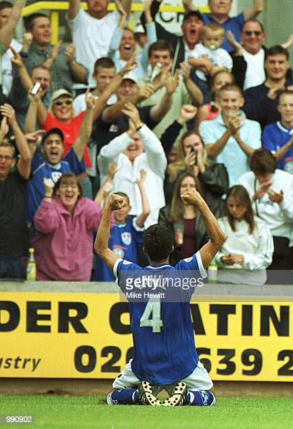Tim Cahill of Millwall celebrates scoring the 3rd goal during the Nationwide Division One match between Millwall and Norwich City at The Den London...