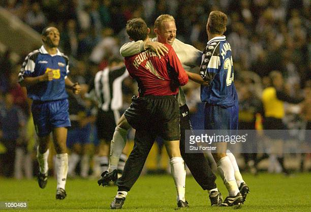 Troyes players celebrate after winning on away goals at the end of the Intertoto Cup Final Second Leg between Newcastle United and Troyes at St James...